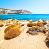 In greece the mykonos island rock sea and beach blue   sky Royalty Free Stock Photo