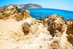 In greece the mykonos island rock sea and beach blue   sky Stock Image