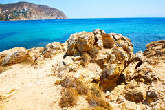 In greece the mykonos island rock sea and Royalty Free Stock Image