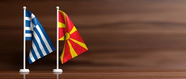 Greece and North Macedonia relations. Miniature flags on wooden background, banner. 3d illustration. Greece and North Macedonia relations. Miniature flags on stock illustration