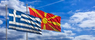 Greece and North Macedonia waving flags on blue sky background. 3d illustration stock photo