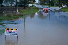 Flood on the outskirts of town in Greece. stock photo