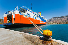 Greece, Panormitis-July 14: The ferry at the pier in the harbor on July 14, 2014 in Panormitis, Greece Royalty Free Stock Images