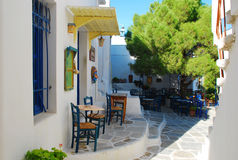 Greek sidewalk cafe restaurant. Paros, Greece. Typical greek street cafe on Paros Island, Greece. Sidewalk seating, dining alfresco royalty free stock photography