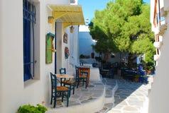 Greek sidewalk cafe restaurant. Paros, Greece Royalty Free Stock Photography