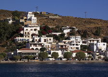 Greece, Patmos Skala from the sea. Greece Dodecanese islands Patmos The whitewashed buildings of Skala viewed from the Aegean sea - Patmos is a Unesco World Royalty Free Stock Photo