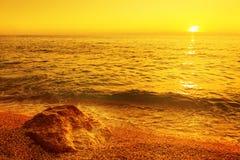 Greece pebble beach at summer sunset. Greece beautiful pebble beach at summer sunset stock image