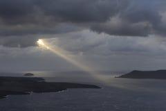 Greece. Piercing sunbeam over Santorini island. Greece. Piercing sunbeam over islands near Santorini and volcano royalty free stock image