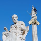 Greece, Plato the philosopher and Athena ancient goddess statues. Plato the philosopher and Athena ancient goddess statues on blue sky background Stock Images