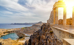 Greece. Rhodes. Acropolis of Lindos. Doric columns of the ancient Temple of Athena Lindia setting sun above the columns Stock Photography