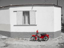Greece, Rhodes, April 2019. Red motorbike next to black and white traditional white village house stock images
