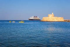 Greece, Rhodes - July 19  Cruise ship on the background of the fortress of St. Nicholas  on July 19, 2014 in Rhodes, Greece Royalty Free Stock Images