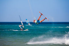 Greece, Rhodes - July 16 Kitesurfer jumping on Prasonisi on July 16, 2014 in Rhodes, Greece stock photos