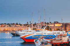 Greece, Rhodes - July 13  Port city and fortress walls on July 13, 2014 in Rhodes, Greece Stock Photography
