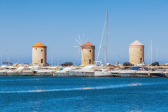 Greece, Rhodes - July 12  Windmills at Mandraki Harbour on July 12, 2014 in Rhodes, Greece Royalty Free Stock Photos