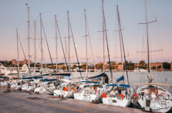 Greece, Rhodes - July 13  Yachts in the harbor Mandraki morning on July 13, 2014 in Rhodes, Greece Stock Photography