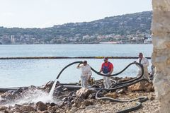 Greece. Salamis Island.  November 5, 2017. Workers continue to r. Emove  oil that spilled from the tanker Agia Zoni , sunk in the Saronic Gulf. Environmental Stock Photo