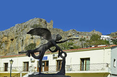 Greece, Samothrace Island. Chora, Greece - September 19, 2016: Sculpture of Goddess Nike in front of health center buildingl and ruin of fortress in the mountain Stock Photography