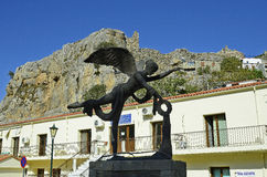 Greece, Samothrace Island. Chora, Greece - September 19, 2016: Sculpture of Goddess Nike in front of health center buildingl and ruin of fortress in the mountain Stock Photos