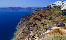 Greece, Santorini. Amazing view from famous sunset point on island in Aegean sea - Santorini over Oia - Ia village at the slope of stock photo