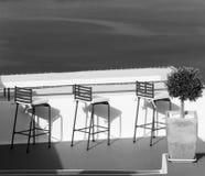 Greece. Santorini island. An open air cafe over the sea. In blac Stock Photography