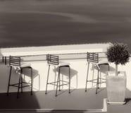 Greece. Santorini island. An open air cafe over the sea. In sepi Stock Photo