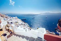 Greece, Santorini - October 01, 2017: vacationing people on the narrow streets of white cities on the island. Favorite place of all lovers Royalty Free Stock Images