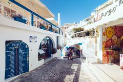 Greece, Santorini - October 01, 2017: vacationing people on the narrow streets of white cities on the island. Favorite place of all lovers Royalty Free Stock Photos