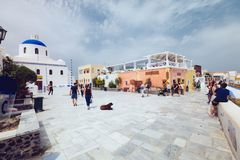 Greece, Santorini - October 01, 2017: vacationing people on the narrow streets of white cities on the island. Stock Photography