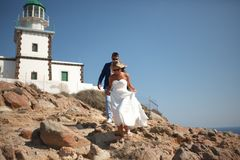 Greece, Santorini, Oia. September 16, 2014: a couple of newly married people in beautiful attire enjoying their honeymoon months. In Greece adult aegean stock image