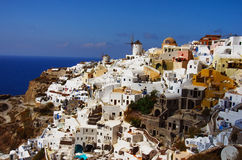 GREECE, SANTORINI, OIA TOWN. Oia town on Santorini island, Greece. Traditional and famous houses and churches with blue domes over the Caldera, Aegean sea Stock Image