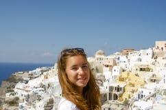 GREECE, SANTORINI, OIA TOWN. Young beautiful girl in Santorini Greece Royalty Free Stock Image