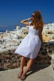 GREECE, SANTORINI, OIA TOWN. Young beautiful girl in Santorini, Oia town Royalty Free Stock Images