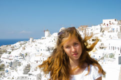 GREECE, SANTORINI, OIA TOWN. Young beautiful girl. Windy day. Santorini Greece Stock Photography