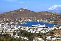 Greece/Skala:  The Port of Patmos. The only port of Patmos is Skala. A Finnish cruise ship lies at anchor in the harbor Royalty Free Stock Photos