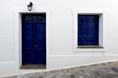 Greece Skopelos Blue Door Window. Old fashioned blue window on the white wall Royalty Free Stock Photography