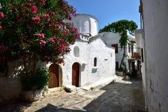 Greece, Skopelos Island, Skopelos Town. White Chapel at Skopelos Town Alley Stock Images
