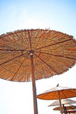 Greece, sunny umbrellas. Greece, umbrellas on the sun on the beach Royalty Free Stock Photo