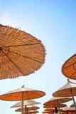 Greece, sunny umbrellas. Greece, umbrellas on the sun on the beach Stock Image
