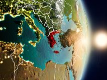 Greece during sunrise. Highlighted in red on planet Earth with visible country borders. 3D illustration. Elements of this image furnished by NASA Royalty Free Stock Images