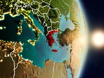 Greece during sunrise. Highlighted in red on planet Earth with visible country borders. 3D illustration. Elements of this image furnished by NASA Royalty Free Stock Photo