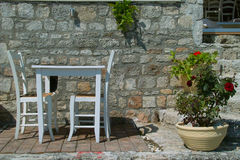 Greece taverna. The photo shows a detail from the Greek tavernas, old table and chairs were done uniformly, are traditional furniture in taverns and are usually royalty free stock photography
