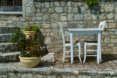 Greece taverna. The photo shows a detail from the Greek tavernas, old table and chairs were done uniformly, are traditional furniture in taverns and are usually stock photos