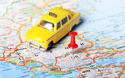 Greece taxi map. Close up of Greece map , red pin and a taxi toy - Travel concept stock photo