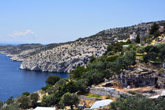 Greece, Thassos Island. Monastery Archangelou on Aegean sea, damaged chapel from forest fire in foreground royalty free stock photos