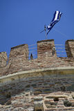 Greece, Thessaloniki. Battlements, raven and Greek flag on top of Withe Tower Stock Photo