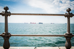 Greece, Thessaloniki, about july 2015, Tankers in harbor, viewed through the bars.  Royalty Free Stock Photography