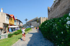 Greece, Thessaloniki, tourists are photographed on a narrow stre Stock Photo