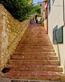 Greece, tourists on stairs of a greek island village Royalty Free Stock Images