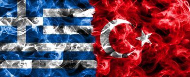 Greece and Turkey smoke flag. Isolated on a black background stock photos
